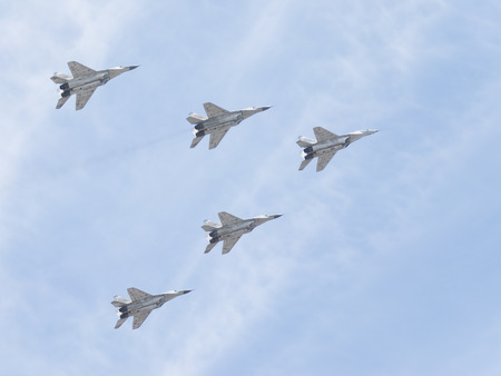 may 9: Moscow - May 9, 2015: Five MiG-29 flying in the sky at the parade in honor of the 70th anniversary of Victory in the Great Patriotic War May 9, 2015, Moscow, Russia Editorial