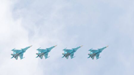 modern fighter: Moscow - May 9, 2015: Victory Parade in Red Square and four modern military aircraft SU-34 in the sky May 9, 2015, Moscow, Russia Editorial