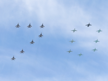 may 9: Moscow - May 9, 2015: MiG-29 and Su-25 painted in the sky figure 70 in honor of the 70th anniversary of Victory in the Great Patriotic War May 9, 2015, Moscow, Russia Editorial