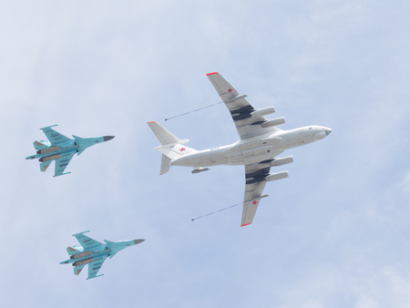 may 9: Moscow - May 9, 2015: The IL-78 provides aerial refueling of two Su-34 in the sky May 9, 2015, Moscow, Russia