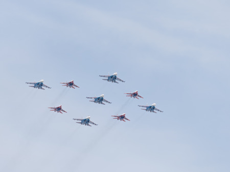 guppies: Moscow - May 9, 2015: SU-27 and MIG-29 draw aerobatics diamond in the sky over Red Square May 9, 2015, Moscow, Russia