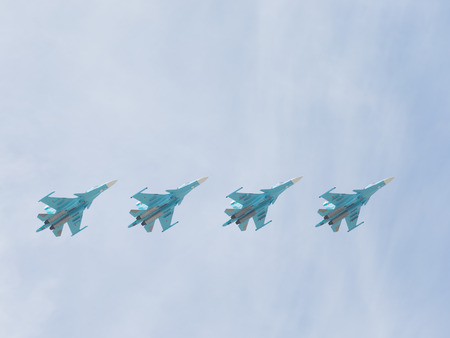 modern fighter: Moscow - May 9, 2015: SU-34 sroem flying in the sky over Red Square May 9, 2015, Moscow, Russia Editorial