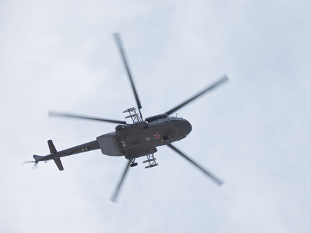 rotates: Moscow - May 9, 2015: Mi-8 helicopter in the sky over Red Square May 9, 2015, Moscow, Russia