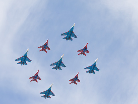 guppies: Moscow - May 9, 2015: SU-27 and MIG-29 draw diamond in the sky over Red Square May 9, 2015, Moscow, Russia