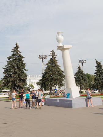 fragility: Moscow - August 13, 2015: Installation Falling column of fragility Rostand Tavasieva ENEA in the park and people are walking around in good weather, August 13, 2015, Moscow, Russia