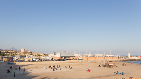 petanque: El Campello - 2 October 2015: People playing petanque, walk and relax on the beautiful beach at the blue sea October 2, 2015, El Campello, Spain