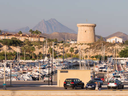 cuccette: El Campello - 2 October 2015: fishing port and many small fishing vessels are on berths El Campello night and visible tower and mountains and people visiting the sights of October 2, 2015, El Campello, Spain