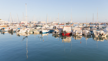 cuccette: El Campello - 2 October 2015: fishing port and many small fishing vessels are on berths El Campello evening and beautifully illuminated by sunlight reflected in the water, and October 2, 2015, El Campello, Spain