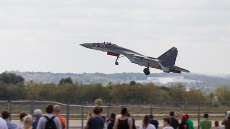 mutually: The Moscow region - August 28 2015: MiG 35 taking off and the audience look at Airshow Max 2015 August 28, 2015, Zhukovsky, Moscow Region, Russia