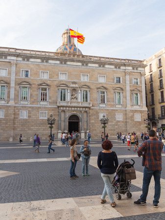 Barcelona - 10 October 2015: the Palau de la Generalitat - the seat of government and the Presidency of the Generalitat de Catalunya, and people walk October 10, 2015, Barcelona, Catalonia, Spain