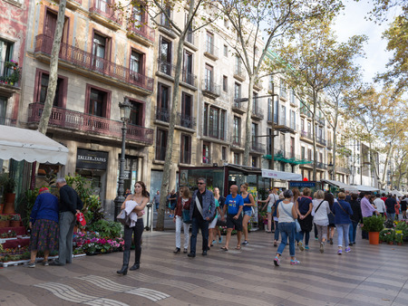 ramblas: Barcelona - 10 October 2015: Spains most famous street, Las Ramblas and the many tourists strolling October 10, 2015, Barcelona, Catalonia, Spain