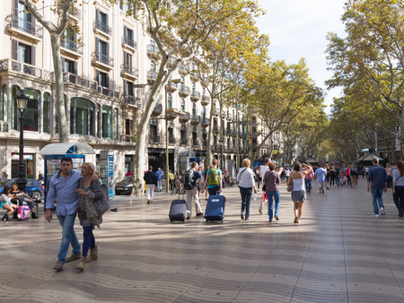 ramblas: Barcelona - 10 October 2015: Spains most famous street, Las Ramblas and a lot of people walk October 10, 2015, Barcelona, Catalonia, Spain
