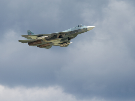 supersonic: Moscow region - 17 June 2015: the Su-50 - Single maneuverable supersonic multi-role fighter of the fifth generation in the demonstration flights in Kubinka June 17, 2015, Kubinka, Moscow Region, Russia Editorial