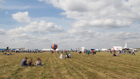 walk in: The Moscow region - August 28 2015: A lot of people walk and rest at an air show at the airfield in Zhukovsky, August 28, 2015, Zhukovsky, Moscow Region, Russia Editorial