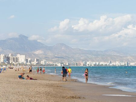 good weather: Alicante -13 October 2015: Many people and tourists resting on the wide beach of the Costa Blanca town in good weather October 13, 2015 Alicante, Spain