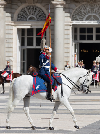 Madrid - 7 October 2015: Changing of the guard at the Royal Palace and the beautiful horse riders galloping along the Armoury Square October 7, 2015, Madrid, Spain