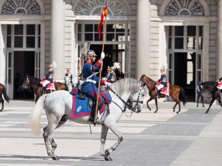armory: Madrid - 7 October 2015: Changing of the guard at the Royal Palace and the brave riders on horseback gallop at Armory Square October 7, 2015, Madrid, Spain