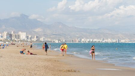 good weather: Alicante -13 October 2015: Many people and tourists resting on the wide beach of the city of Alicante Costa Blanca in good weather, October 13, 2015 Alicante, Spain