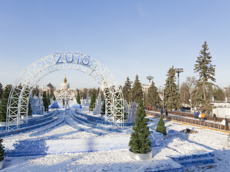 enea: Moscow - November 28, 2015: A lot of happy people rest and ice-skating in a wonderful park ENEA and a large arch with the inscription 2016 November 28, 2015, Moscow, Russia