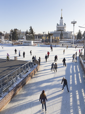 rest day: big rink, people, ride, tourists, Exhibition Center, Moscow, Russia, rest, happiness, fun, vacation, walking, skating, ice, winter clothing, stripes, beautiful, sunny day, the sky blue, the park, joy, winter, sport, season, landmark, rim, smooth, surface, Editorial