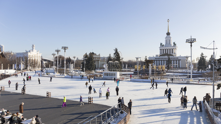 enea: Moscow - November 28, 2015: Lots of happy cheerful people skate on the big rink in a wonderful park Exhibition Center November 28, 2015, Moscow, Russia Editorial