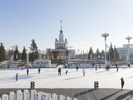 walk in: Moscow - November 28, 2015: A lot of people walk and skate on long ice track in a huge wonderful park ENEA winter November 28, 2015, Moscow, Russia Editorial