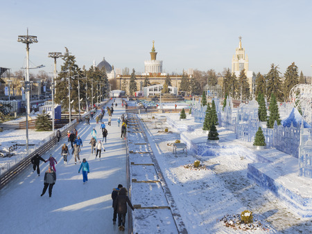 enea: Moscow - November 28, 2015: Many gay people walk and skate on long ice track in a huge wonderful park ENEA winter November 28, 2015, Moscow, Russia