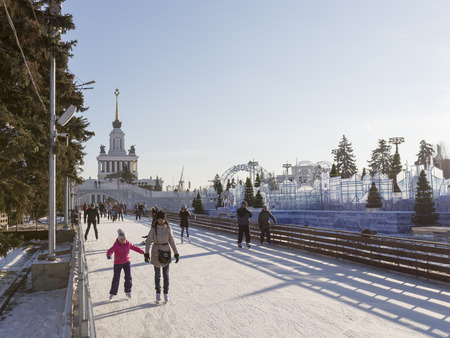 enea: Moscow - November 28, 2015: A lot of people walk and skate on a beautiful long ice track in a huge wonderful park ENEA winter November 28, 2015, Moscow, Russia