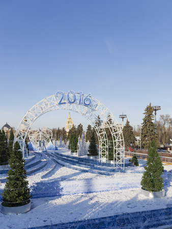 enea: Moscow - November 28, 2015: A large arch with the inscription 2016 and people ice-skating in the park ENEA November 28, 2015, Moscow, Russia