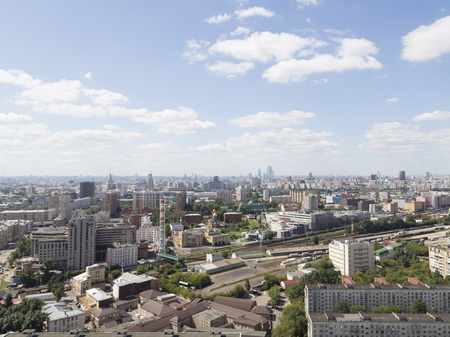 car lots: Moscow - 25 July 2015: Aerial view of Moscow and in the distance the skyscrapers Moscow City and District Sokolniki June 25, 2015, Moscow, Russia