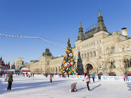 60s: Moscow - November 29, 2015: People skating on the Red Square in Moscow and the Christmas tree is decorated in the style of 60s of the last century, 29 November 2015, Moscow, Russia