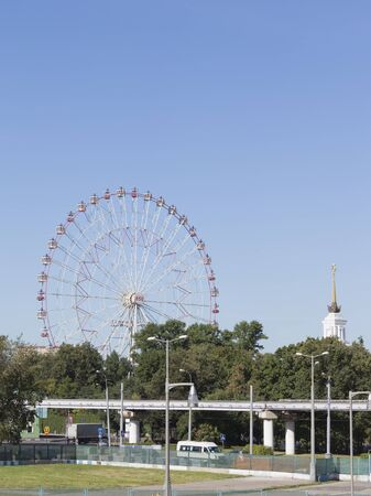 good weather: Moscow - August 13, 2015: Ferris Park Exhibition Center and the monorail, in good weather in the summer in the city of 13 August 2015, Moscow, Russia