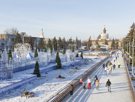enea: Moscow - November 28, 2015: A lot of happy people relax and ride on Christmas winter outdoor rink in a wonderful park decorated with ENEA November 28, 2015, Moscow, Russia Editorial
