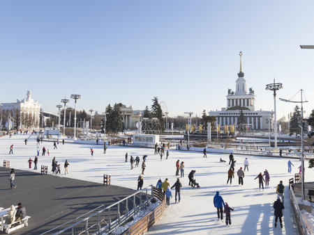 enea: Moscow - November 28, 2015: A lot of happy people relax and ride on Christmas winter outdoor rink in a wonderful park Exhibition Center November 28, 2015, Moscow, Russia