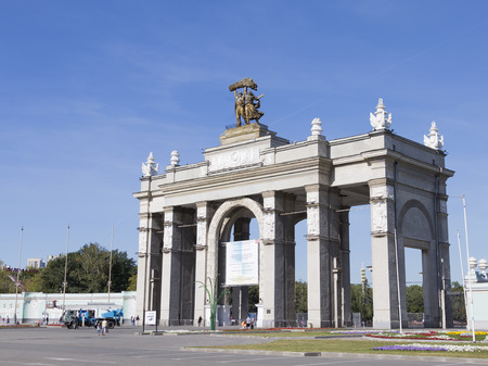 walk in: Moscow - August 24, 2015: The main entrance to the park ENEA and people go for a walk in the park in the morning, in the summer in good weather is sunny August 24, 2015, Moscow, Russia