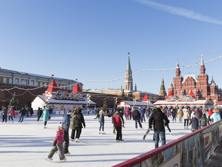 iceskating: Moscow - November 29, 2015: Festive ice rink on Red Square, Historical Museum, and people ice-skating at the Kremlin November 29, 2015, Moscow, Russia
