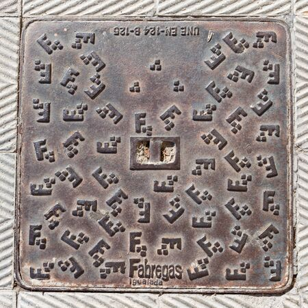 fabregas: Madrid - October 11, 2015: Beautiful heavy metal manhole cover on the road October 11 Madrid, Spain