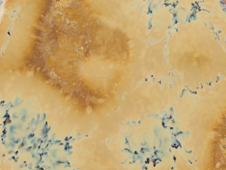 saturated color: beautiful ocher brown texture with blur and dark blue patches on the surface of the ceramic mosaics