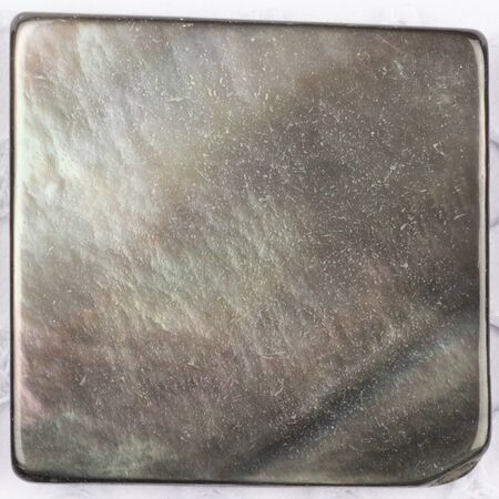 overflows: beautiful natural pearl black pearl with iridescent tints in the form of a square plate for mosaic