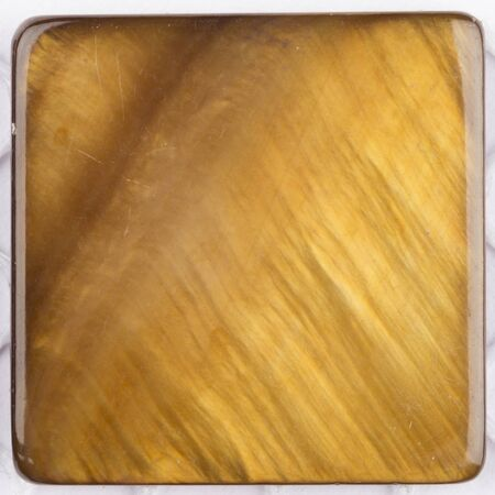 overflows: unusual beautiful natural light ocher brown pearl pearl with iridescent tints in the form of a square plate for mosaic Stock Photo