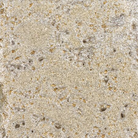 dent: beautiful light beige surface of natural stone with a gold patina dent