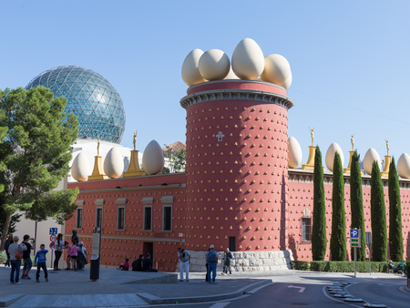 Figueres - October 11, 2015: Many tourists have unusual theater-museum of Salvador Dali in the background of blue sky October 11, 2015 Figueres, Catalonia, Spain