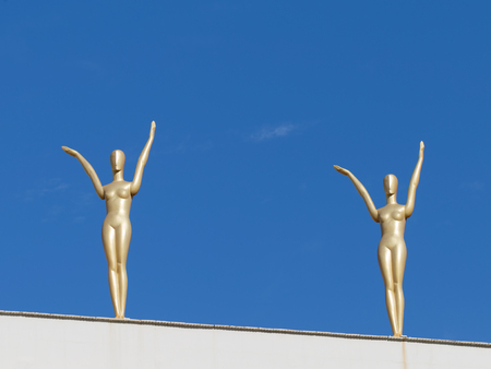 salvador dali: Figueres - October 11, 2015: Golden female figures on the building of the theater-museum of Salvador Dali in the background of blue sky October 11, 2015 Figueres, Catalonia, Spain Editorial