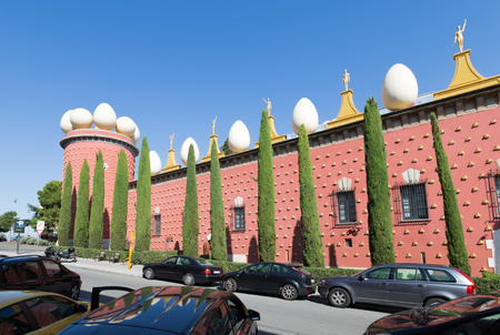 Figueres - October 11, 2015: Many machines have unusual theater-museum of Salvador Dali in the background of blue sky October 11, 2015 Figueres, Catalonia, Spain