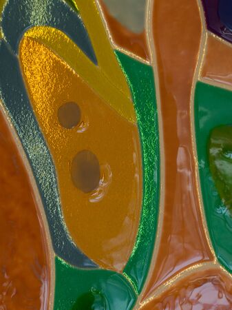 abstract stained glass of colored stained glass illuminated in modern technology fusing Фото со стока