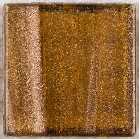 aventurine: beautiful square glass mosaic with light brown stripes and patches of diffuse aventurine
