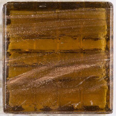 aventurine: beautiful honey brown square glass mosaic with patches of brilliant aventurine
