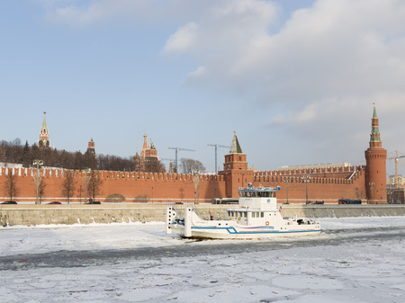 ensemble: Moscow - January 7, 2016: The ship - the icebreaker splits the ice on the river Moscow, at the walls of Moscow Kremlin in winter January 7, 2016, Moscow, Russia