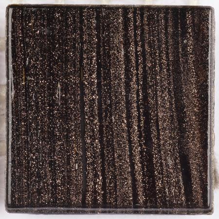 aventurine: small glass square glossy dark brown Smalt with blurred stripes aventurine Stock Photo