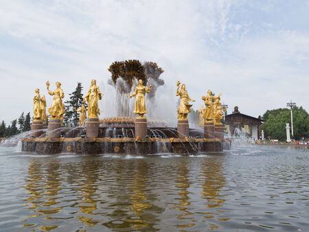 enea: Moscow - August 13, 2015: A beautiful fountain with golden sculptures, which are reflected in the water, in the beautiful city park ENEA August 13, 2015, Moscow, Russia